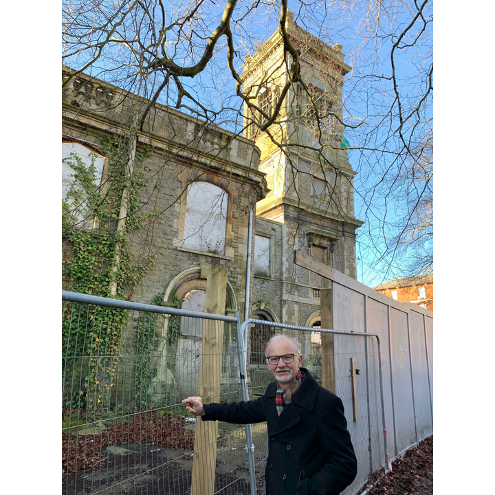 Councillor Stan Pajak standing next to the Locarno building